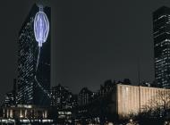 """Film """"Migracja Wertykalna"""" na fasadzie budynku ONZ"""